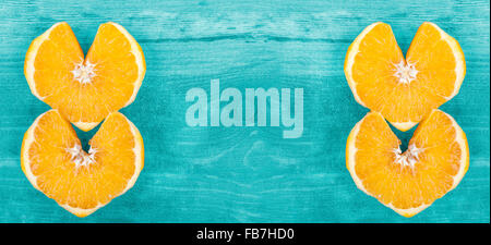 Background with heart shape orange slices, space for text. - Stock Photo