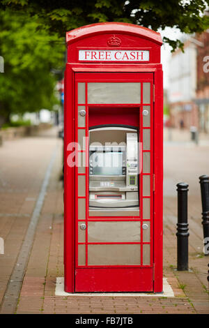BBC Music day 'for the love of music'  Hadrian's Wall of Sound 2015 at Carlisle atm in a red telephone box converted - Stock Photo