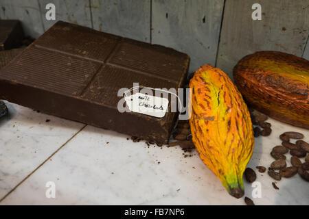 Milk chocolate bar and cacao pod - Stock Photo