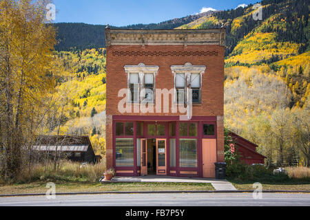 Victorian building with fall colors in mountainous Rico, Colorado - Stock Photo