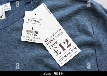 clothing price tag on Topman T-shirt - Stock Photo