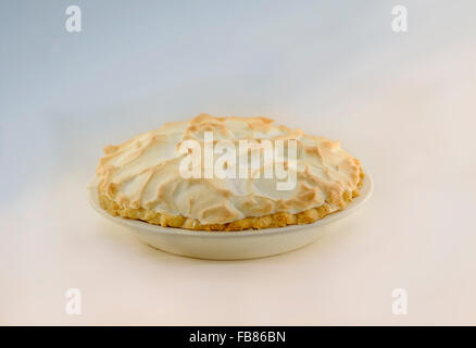 A whole homemade lemon meringue pie with bicolor background. USA. - Stock Photo