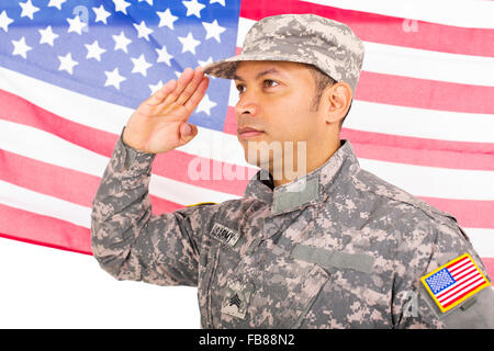 portrait of American soldier saluting on us flag background - Stock Photo