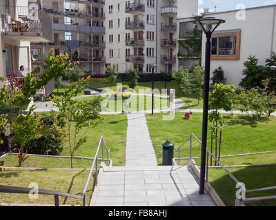 Sweden, Sodermanland, Hammarby Sjostad, Children (4-5, 12-13) playing in residential area - Stock Photo