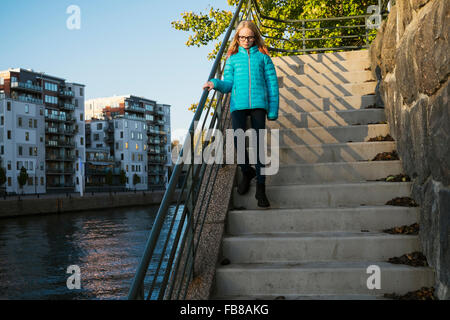 Sweden, Sodermanland, Hammarby Sjostad, Girl (12-13) walking down steps - Stock Photo