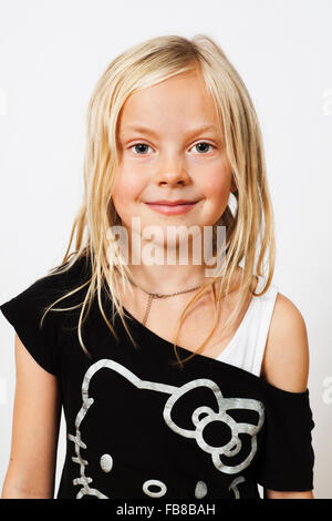Portrait of smiling blonde girl (6-7) - Stock Photo