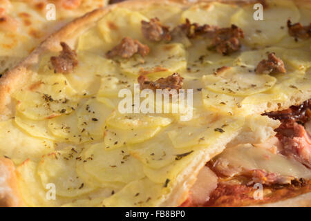 homemade pizza with sausage and potatoes cut in small pieces - Stock Photo