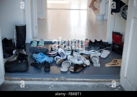 Sweden, Gotland, Shoes in hallway - Stock Photo