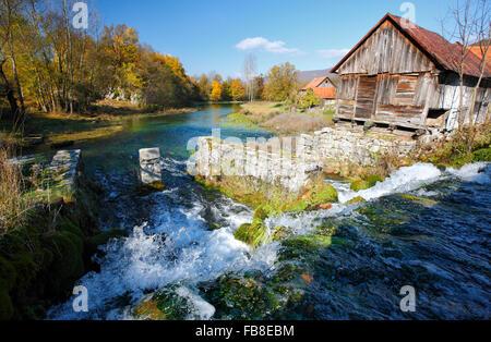 Old mill on river Gacka in Lika (Majerovo vrilo), Croatia. - Stock Photo