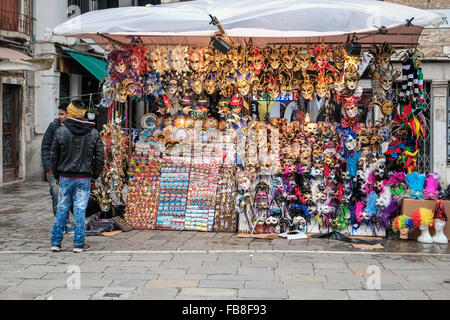 A street gift stall during carnival time in Venice. - Stock Photo