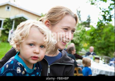 Sweden, Ostergotland, Vikbolandet, Portrait of boy (2-3) at party in backyard - Stock Photo