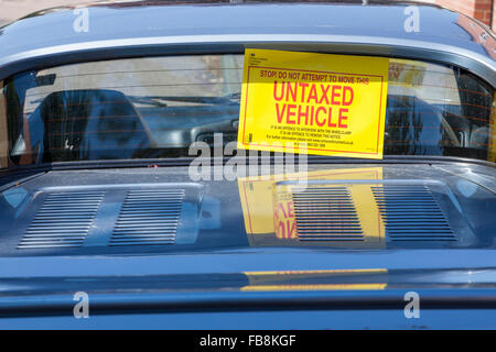 Untaxed vehicle notice on the rear window of a car with no tax paid, England, UK - Stock Photo