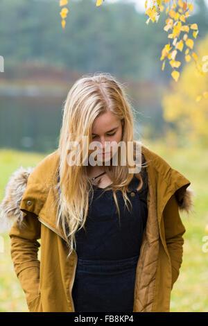 Sweden, Ostergotland, Mjolby, Portrait of blonde teenager (16-17) - Stock Photo