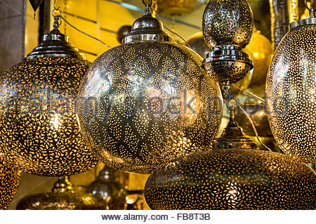 Traditional pierced metalwork lamps in a souk in the Medina (old walled city), Marrakech. These lamps are worked - Stock Photo