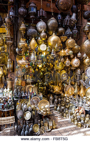 Frontage of metalwork shop, including traditional pierced metalwork lamps, in a souk in the Medina (old walled city). - Stock Photo