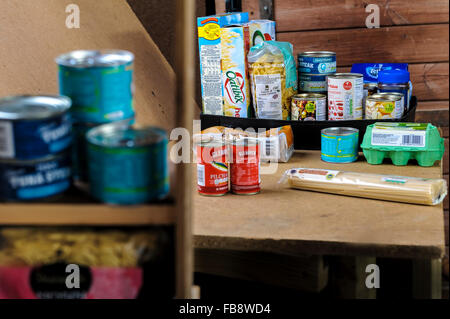Foodstuff's in food bank storeroom ready to be packed for distribution. - Stock Photo
