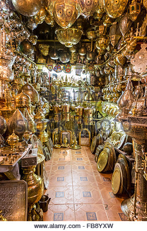 Shop selling lamps and plates in various metals, in the metalwork souk, in the Medina (old walled city), Marrakech. - Stock Photo