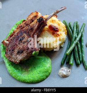 Lamb chop with peas puree and  dauphinoise potatoes - Stock Photo