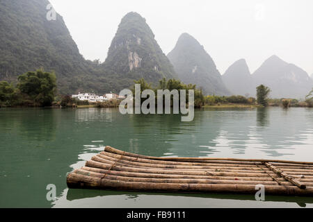Traditional bamboo rafts on the Yulong river - Stock Photo