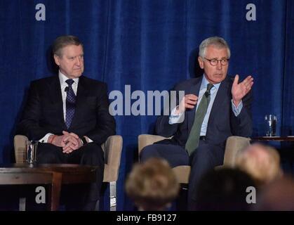 Washington, DC, USA. 11th Jan, 2016. Former U.S. defense secretary Chuck Hagel(R) speaks during an event held by - Stock Photo