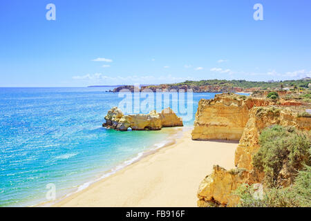 Beach and rock formation known as Praia da Rocha in travel destination Portimao. Algarve, Portugal, Europe. - Stock Photo