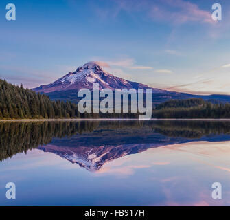 Mount Hood and Trillium Lake at sunrise; Mount Hood National Forest, Oregon. - Stock Photo