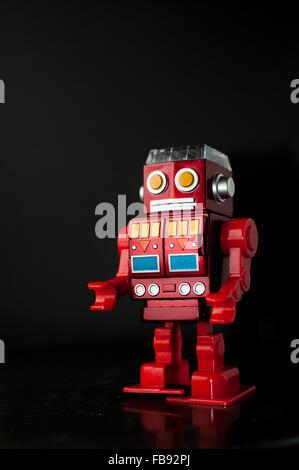 Toy Robot, red plastic walking robot. - Stock Photo