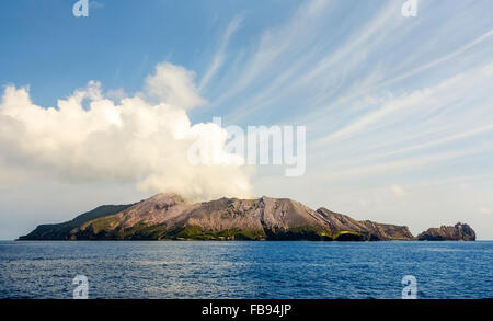 smoke coming from the New Zealand most active volcano - White Island - off the shore of Bay of Plenty - Stock Photo