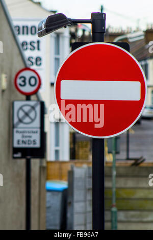 No Entry sign with speed limit in backgroung - Stock Photo