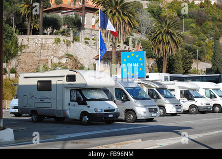 Campervans parked at the former border station between Menton and Ventimiglia, France and Italy. - Stock Photo