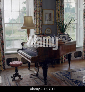 Grand piano in country drawing room - Stock Photo