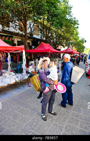 Shaxi,Old Town dating back to 1451,Sideng Square,Temple,Theatre,Friday Market,Yunnan Province,People's Republic - Stock Photo