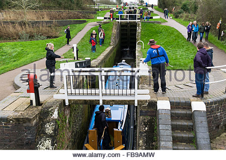 A narrowboat enters one of the locks at Foxton, a staircase of 10 locks on the Grand Union Canal - Stock Photo