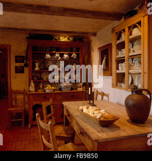 Antique Dresser And Pine Table In Rustic Country Dining Room