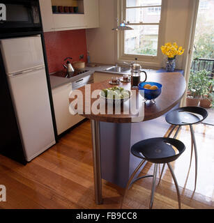 Black Stools At Breakfast Bar With A Burr Veneer Worktop In A Small Modern  Apartment Kitchen