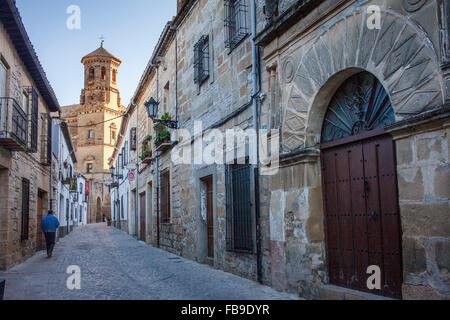 Conde Romanones street, in background Old University building, Baeza. Jaen province, Andalucia, Spain - Stock Photo