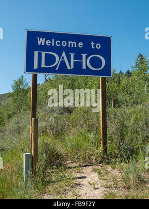 Welcome to Idaho road sign at border with Wyoming in the Tetons - Stock Photo