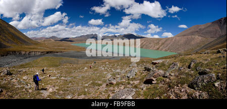 Trekkers descend to a remote glacial lake in the Kharkhiraa Turgen National Park, Mongolia.