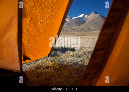 A frosty morning view of the mountains from camp in Kharkhiraa Turgen National Park in remote far-western Mongolia. - Stock Photo