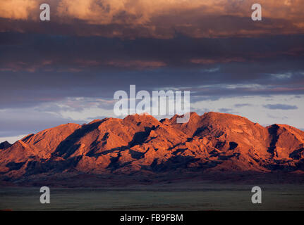 Sunset on the mountains near Khovd and Achit Lake in remote far-western Mongolia. - Stock Photo