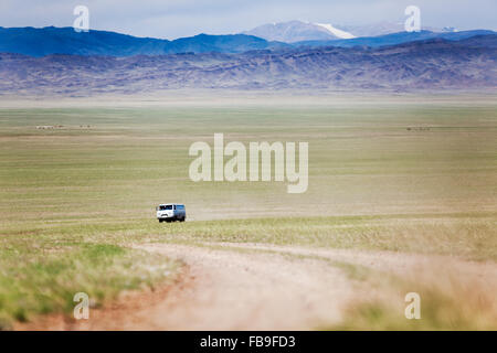A Russian 'bread loaf' van on the road in far-western Mongolia. - Stock Photo