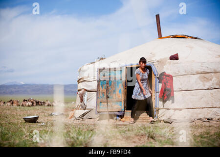Girl emerges from nomad family ger, Mongolia. - Stock Photo