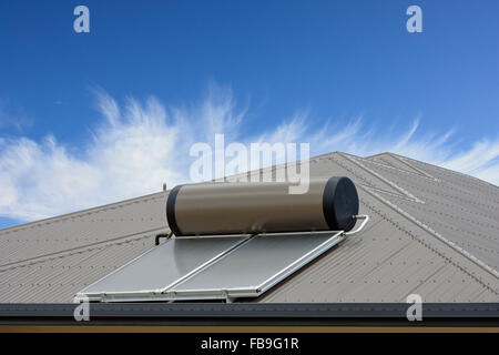 solar panels on roof to heat water from the sun - Stock Photo