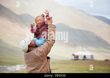 Father and daughter share a laugh Kharkhiraa Turgen National Park, Mongolia. - Stock Photo