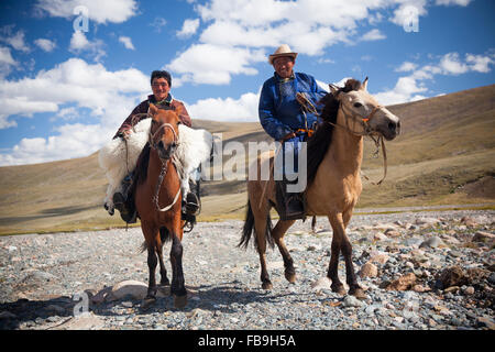 Nomads returning to camp after collecting a runaway sheep in Kharkhiraa Turgen National Park. - Stock Photo