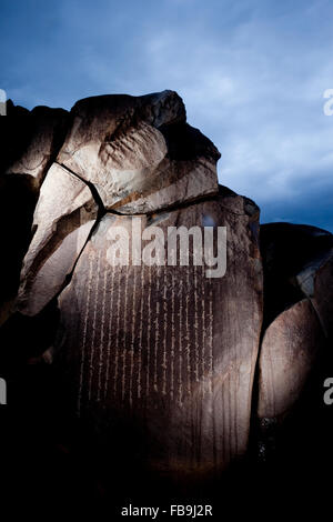 Centuries old Buddhist petroglyphs carved in Mongol script (Hudum Mongol bichig) in a remote part of the Gobi Desert, - Stock Photo