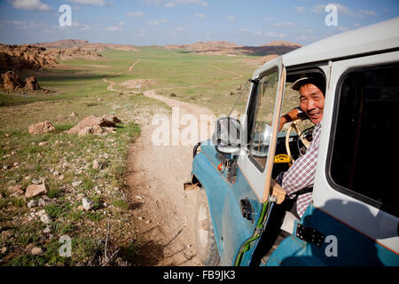 A driver with Tseren Tours on the road in a Russian 4WD in the Gobi Desert, Mongolia. - Stock Photo