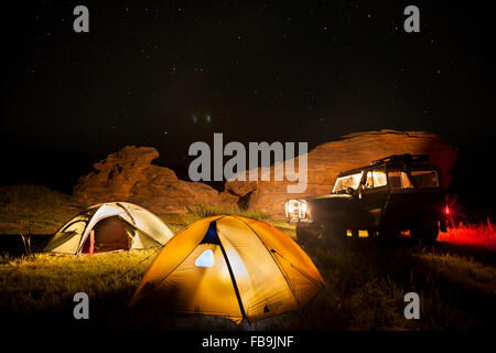 4X4 offroad camping under the stars in the Gobi Desert, Mongolia. - Stock Photo
