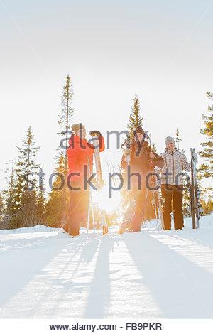 Sweden, Harjedalen, Vemdalen, Klovsjo, Father and daughters standing on ski slope - Stock Photo