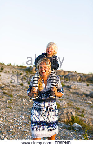 Sweden, Gotland, Faro, Mother playing with little son (2-3) - Stock Photo